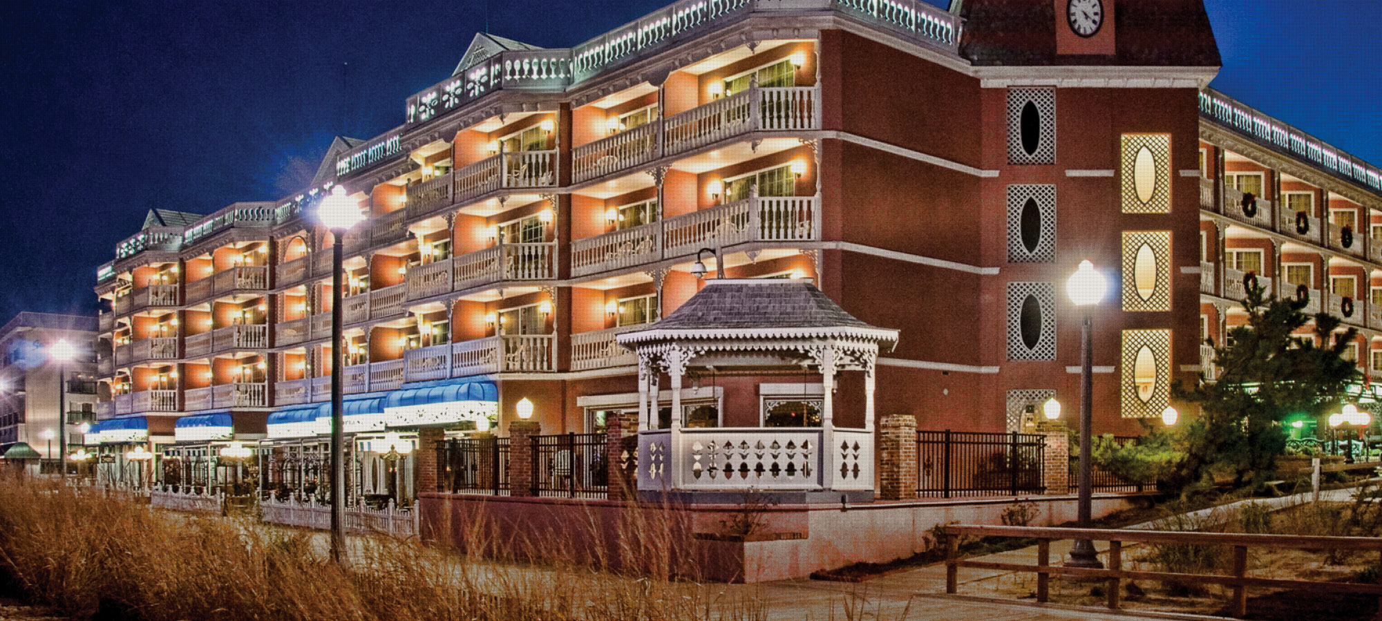 Boardwalk Plaza Hotel Nighttime Exterior Picture In Rehoboth Beach De
