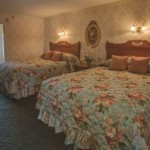 Rehoboth Beach DE Victorian styled hotel room with two medium beds