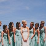Bride and Bridal Party posing on ocean city beach
